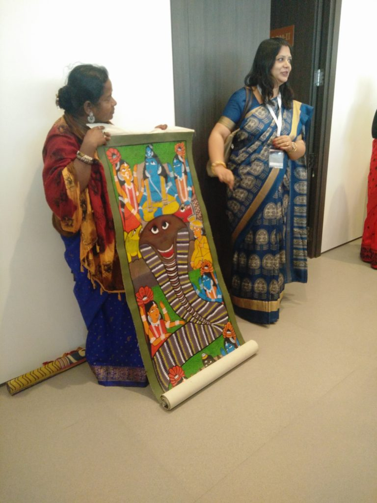 Chitrakar Monimala demonstrating the tradition of Patachitra scroll painting and the singing tradition associated with it, translated to English by a member of the organising committee.