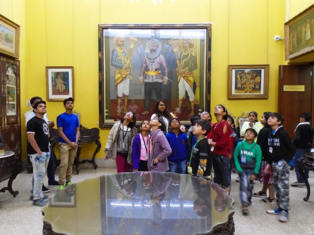 Children enjoying the Gaekwad's collection in the 'Old Baroda Room' of the Maharaja Fatesingh Museum during a storytelling session.